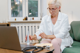Doctor giving healthcare service via telemedicine