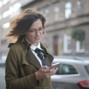 A woman in urban area uses carsharing app as her mobility solution